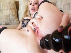 Laura Lion masturbates in her bedrooom with a huge dildo